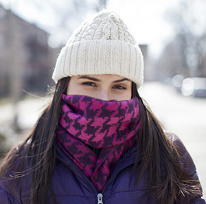 Woman wearing winter scarf over nose and mouth. SOURCE: Original photo. Used in 88795.